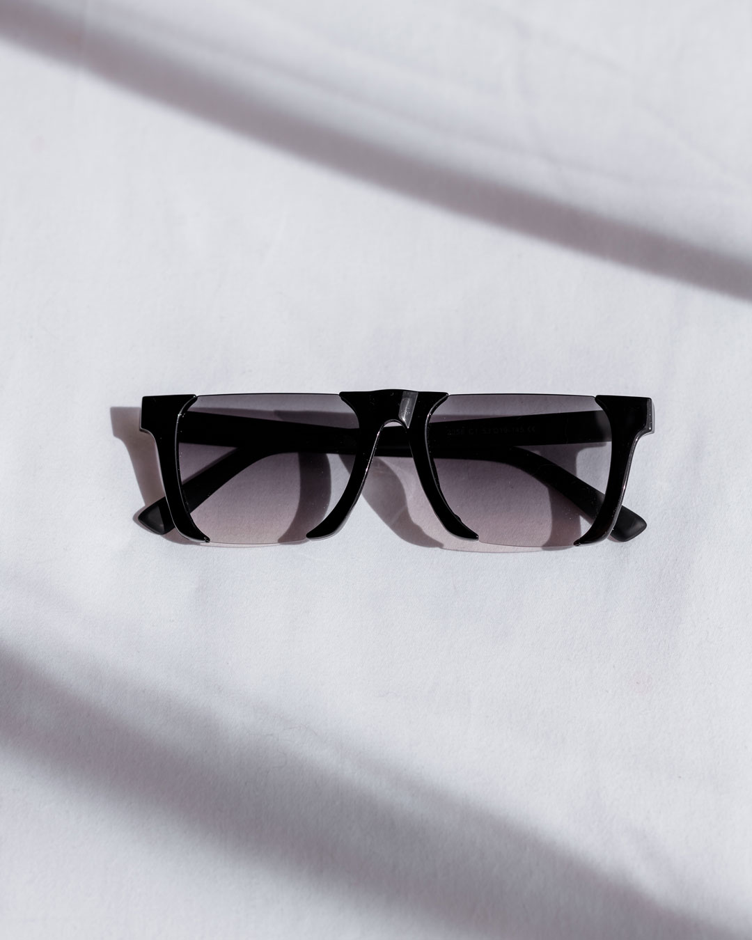black rimless sunglasses