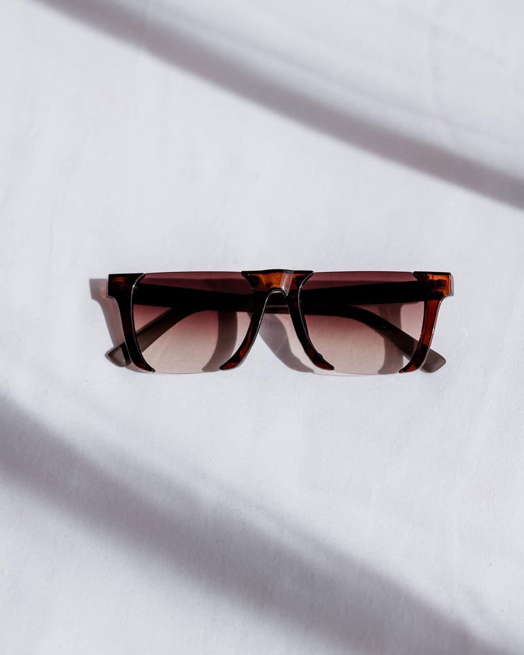 brown rimless sunglasses
