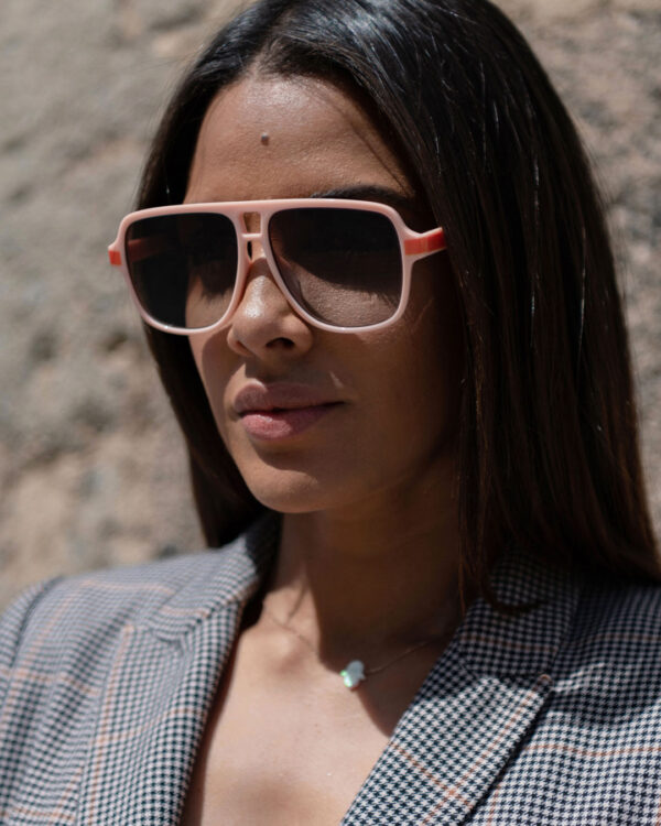 Pink aviator sunglasses on a woman