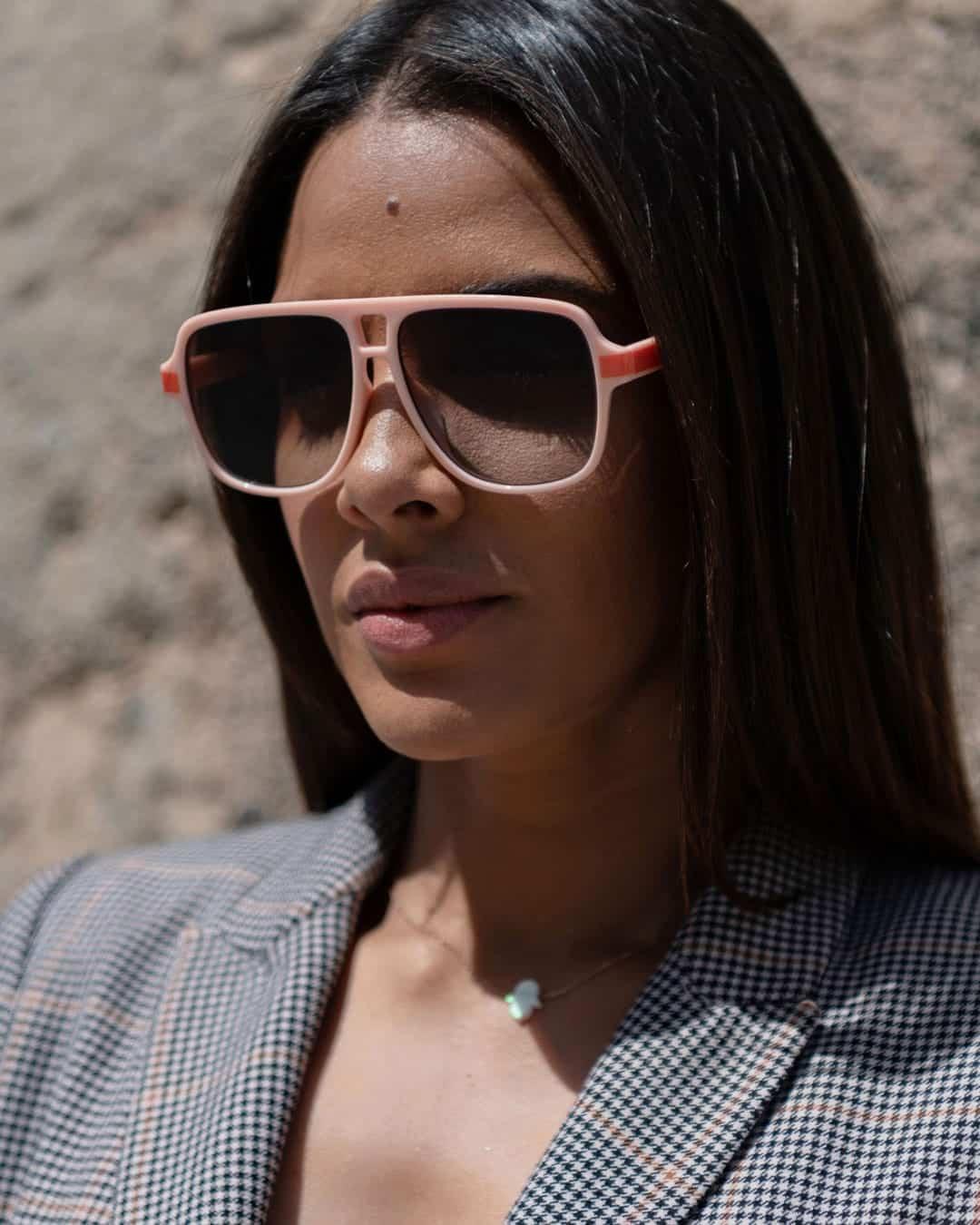 Pink aviator sunglasses on a woman