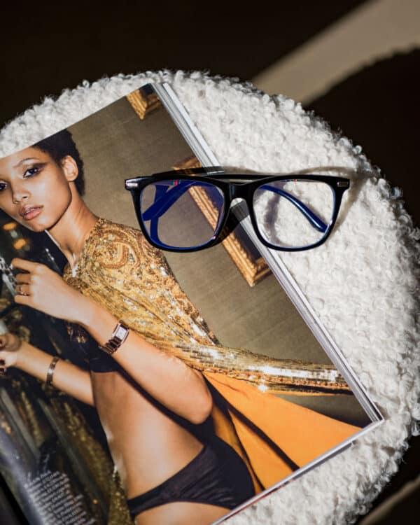 Blue light blocking glasses on a magazine